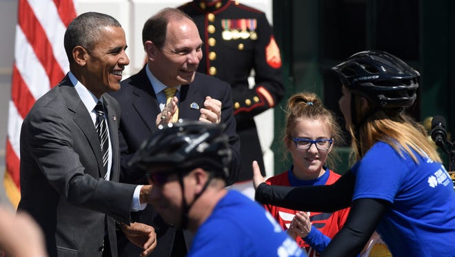 President Barack Obama and Veterans Affairs Secretary Robert McDonald, greet cyclists on the South Lawn of the White House in Washington, April 14, for the start of the Wounded Warrior Ride. The ride is to raise awareness of our nation's heroes who battle the physical and psychological damages of war.