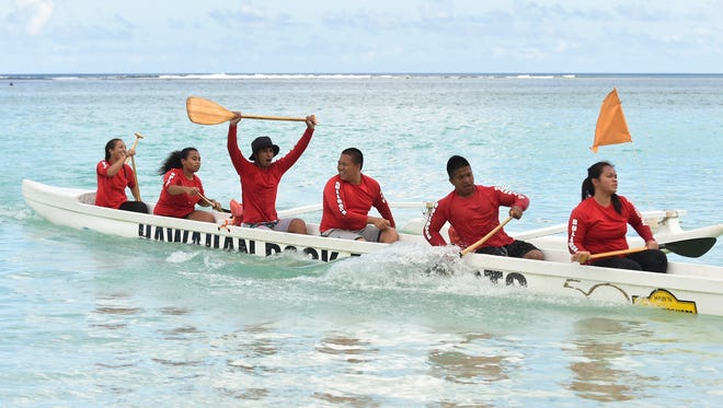 The Okkodo High School Bulldogs celebrate after finishing in the Manhoben Mixed division of the 2015-2016 Guam Kayak & Canoe Federation/Independent Interscholastic Athletic Association of Guam Kareran Galaide paddling race at Matapang Beach in Tumon on April 2.