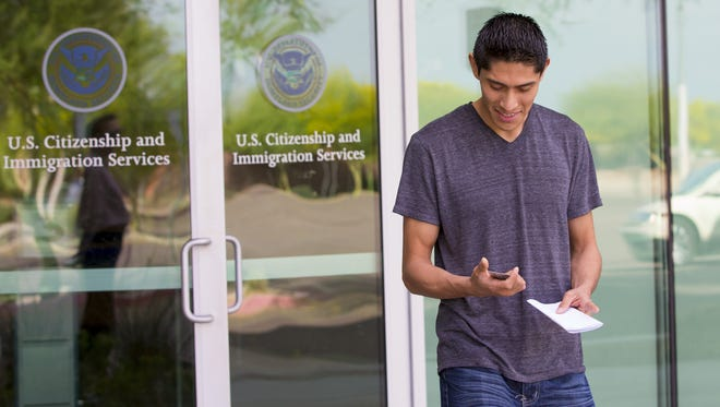 Gerson Gonzalez, 25, leaves the U.S. Citizenship and Immigration Services field office in Phoenix after being fingerprinted as part of the process to renew his DACA card.