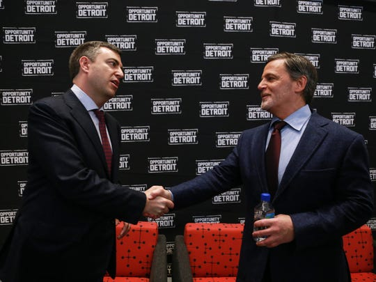 Ally Financial CEO Jeffrey J. Brown (left) and Quicken Loans founder and chairman Dan Gilbert shake hands after a press conference at One Detroit Center in downtown Detroit on Tuesday March 31, 2015 while announcing the purchase of the downtown skyscraper.