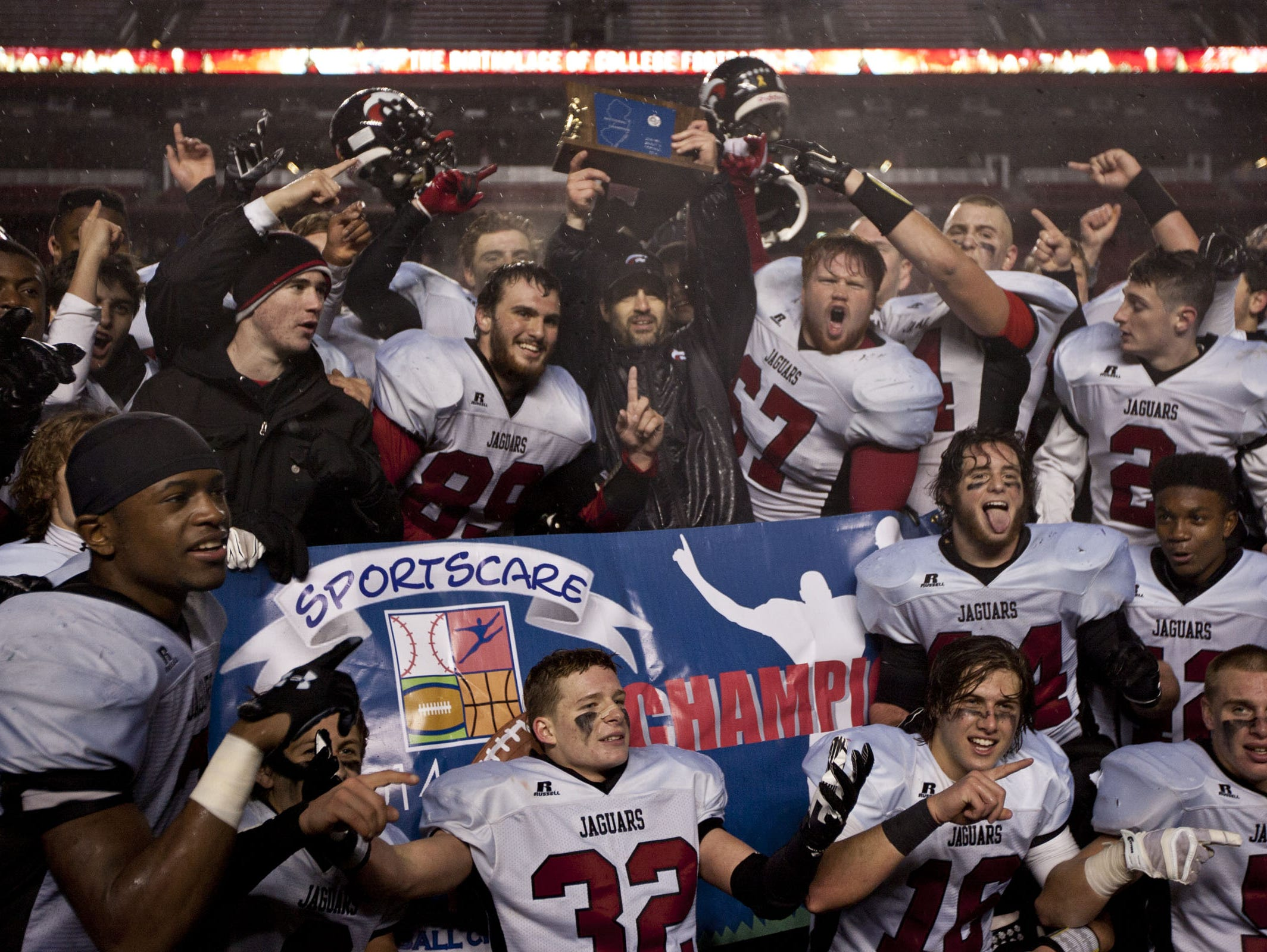 Jackson Memorial players and coaches celebrate after their win over Middletown South in the 2014 CJ Group IV championship game at Rutgers.