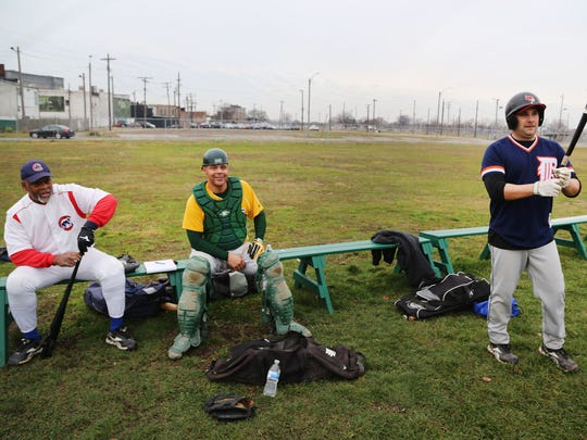 Greg Chastang, left, of Inkster and Greg Wilson, of Detroit , center, and Scott Misuraca of Warren usually participate in baseball with the Men's Senior Baseball League from April-September. They are playing a pick up game at Navin Field  Sunday, Dec. 13, 2015  on Michigan Avenue in Detroit. They say this is their first time ever playing baseball in December.