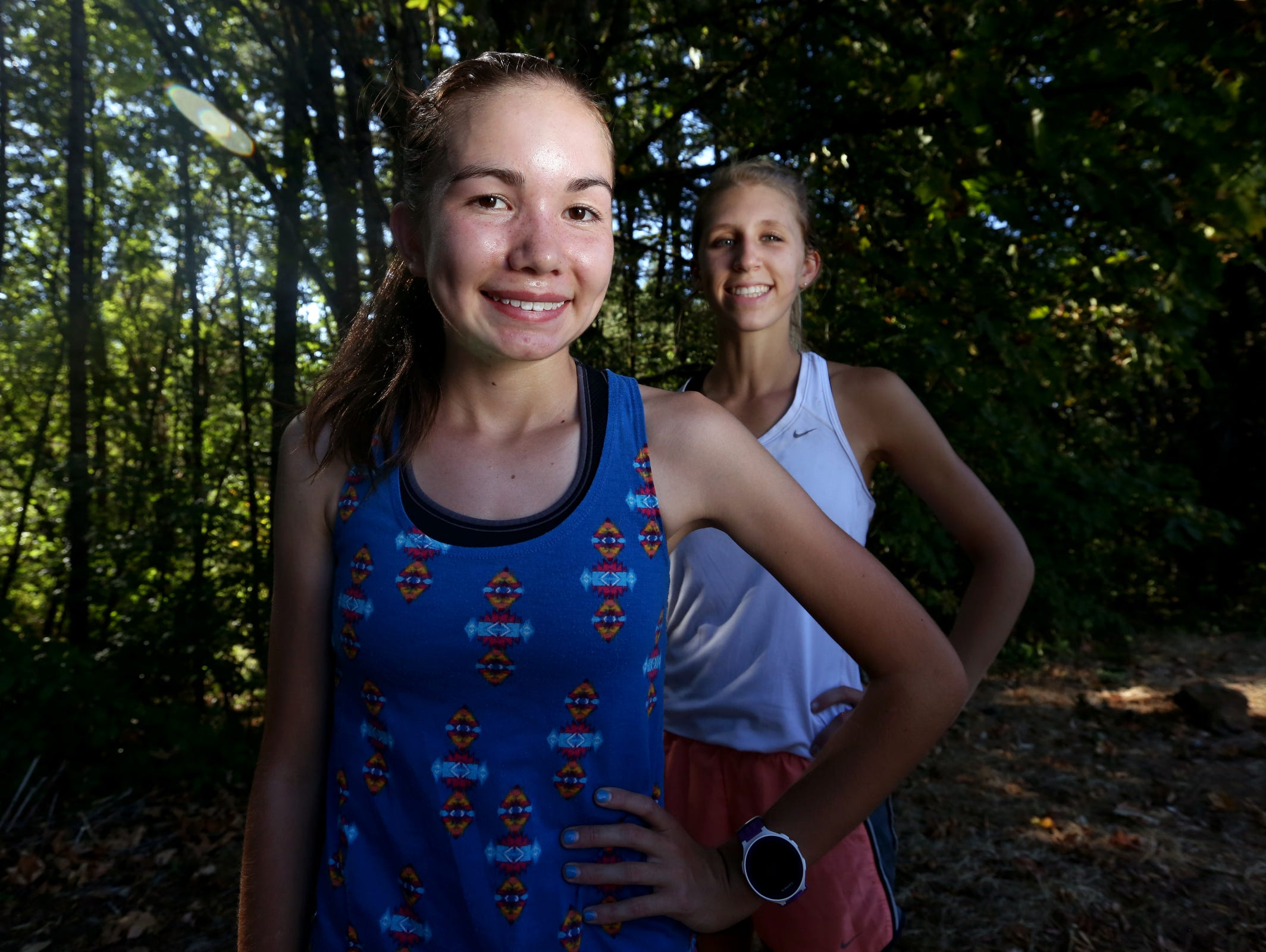 Sophomore Ginger Murnieks, left, and junior Kaylee Mitchell, cross country runners, stand for a portrait at Sprague High School in Salem on Wednesday, Aug. 24, 2016.