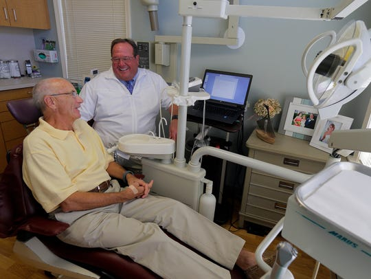 Dr. Richard P. Nobile, DDS speaks with patient Bill