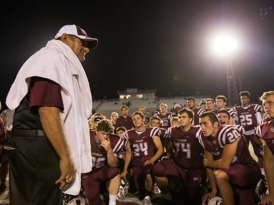 Calallen head coach Phil Danaher talks to his players
