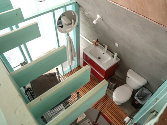 A look into the bathroom from a loft space in one of nine rental units involved in the True North project of Quonset huts in Detroit near Grand River and Warren is seen on Friday December 30, 2016.