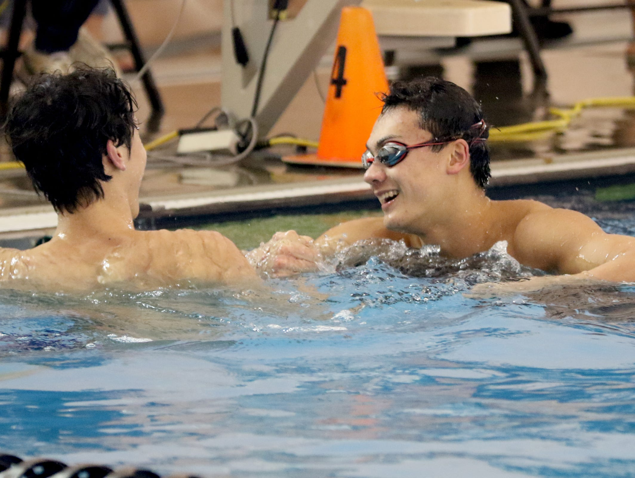 West Salem's Micah Masei, right, shakes hands with Wilson's Evan Carlson after they placed second and first, respectively, in the 50 yard freestyle during the OSAA Class 6A Swimming State Championships at Mt. Hood Community College in Gresham on Saturday, Feb. 18, 2017.