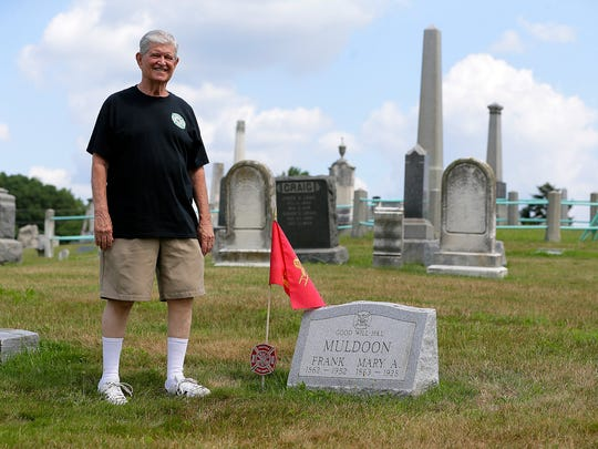 Norman Miles, 79, of Jackson, explains how the Freehold Fire Department's Good Will Hook and Ladder Company tracked down firefighter Frank Muldoon's unmarked grave at Old Tennet Cemetery in Freehold, NJ Monday, July 17, 2017.