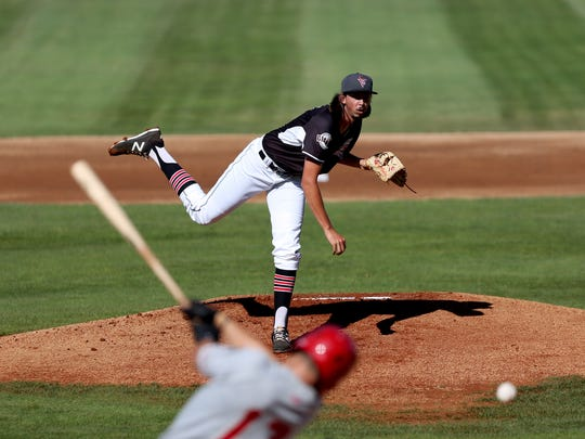 Stetson Woods pitches for the Salem-Keizer Volcanoes at Volcanoes Stadium in Keizer on Sunday, July 23, 2017.