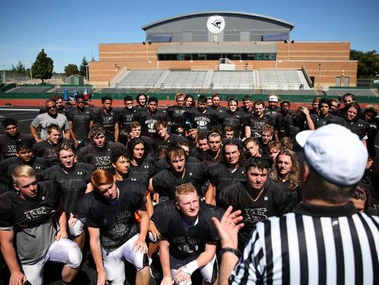 The West Salem High School football team practices