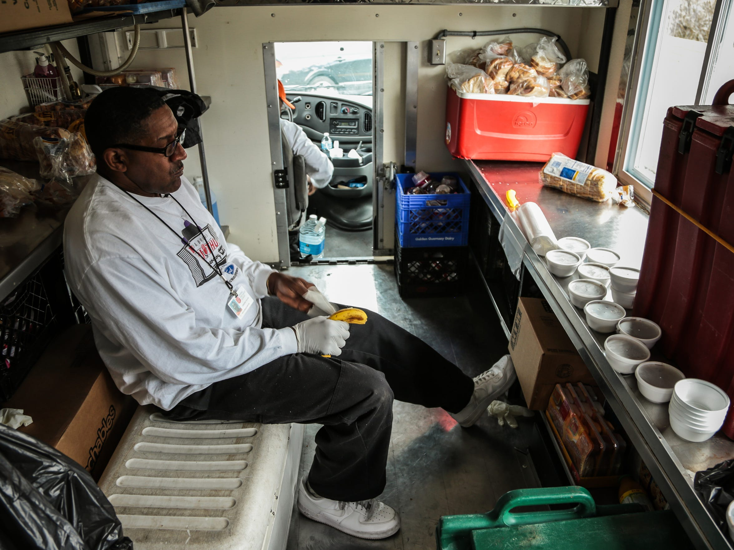 Gregory Taylor, 62, of Detroit, rests for a moment after preparing sandwiches and soups on the Salvation Army's Bed and Bread program food truck before another stop.