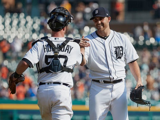 Tigers catcher Bryan Holaday and starting pitcher Matt Boyd celebrate after defeating the  White Sox, 12-0, at Comerica Park on Sunday, Sept. 17, 2017. Boyd had his no-hitter broken up with two outs in the ninth inning.