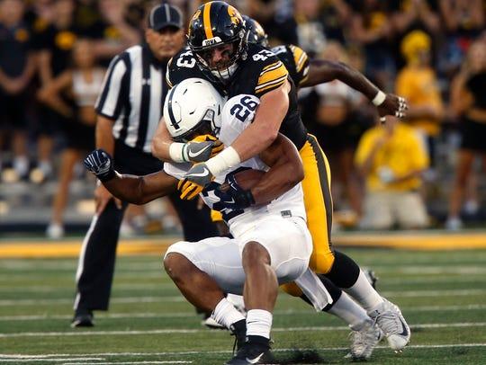 Iowa's Josey Jewell tackles Penn State's Saquon Barkley