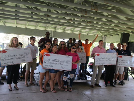 All of the organizations pose with their crews holding the checks and gifts recently donated to them by the Live Like Cole Foundation. Organizations getting checks were: St. Helen Catholic School, $1,500; John Carroll High School, $2,000; Gifford Youth Achievement Center, $1,500; Vero Beach Karate Association, $1,000; and Indian River Soccer Association, $1,000. Christina Tascon