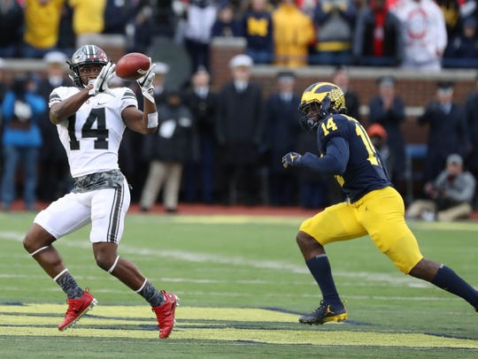 Ohio State's K.J. Hill makes a first-down catch against