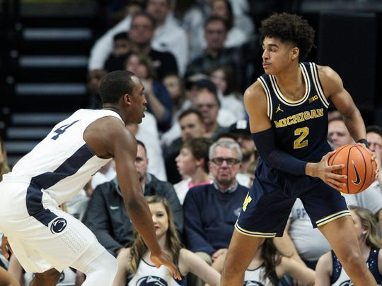 Michigan Wolverines guard Jordan Poole (2) holds the ball as Penn State Nittany Lions guard Nazeer Bostick (4) defends during the first half at Bryce Jordan Center on Wednesday, Feb. 21, 2018.