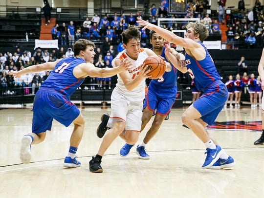 Silverton's David Gonzales (12) weaves through Churchill's defense in a 5A state quarterfinal game on Wednesday, March 7, 2018 at Gill Coliseum in Corvallis. No. 1 seed Silverton lost to Churchill, 53-51.
