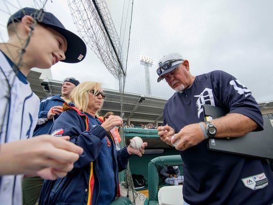 Ron Gardenhire signs autographs for fans prior to the game at Joker Marchant Stadium on Monday.