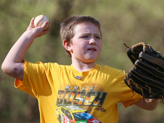 Bryce, 9, plays baseball at his Indianapolis home, where he lives with his grandparents Tammy and Bret Hackman, Thursday, April 12, 2018. When Bryce's mother Tristan Hackman died of a drug overdose in 2015, several of her organs were donated. Knowing her donation saved others' lives has helped her family heal.