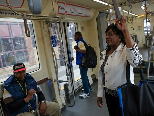 Relynn Nunn, right, of Detroit holds on while riding the QLINE southbound on Woodward Avenue in downtown Detroit on Thursday, May 10, 2018.