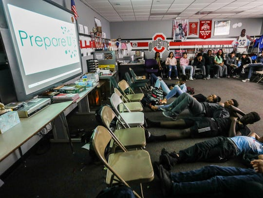 Students watch a video created by PrepareU to talk