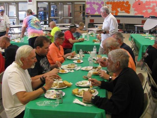 Coast 2 Coast bicycle tour group eats dinner at Columbus