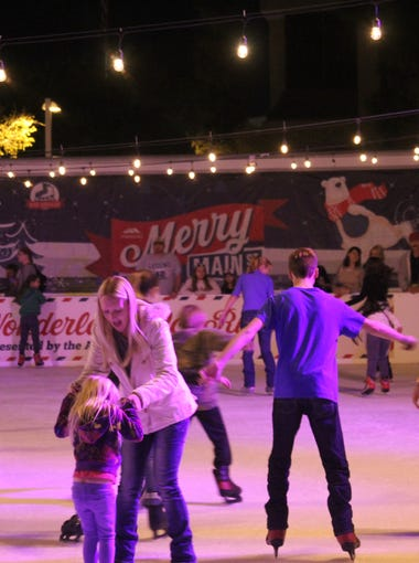 Skaters try out the ice at the Winter Wonderland Ice Rink in Mesa in 2016.