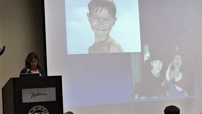 Marissa Wadsworth speaks as photos show her son, T.J. Wadsworth, growing up. She spoke at a fentanyl law enforcement seminar Tuesday at the Radisson Hotel El Paso Airport, 1770 Airway Blvd.