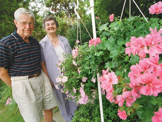 Maurice and Bernie Coles in their backyard Howell garden