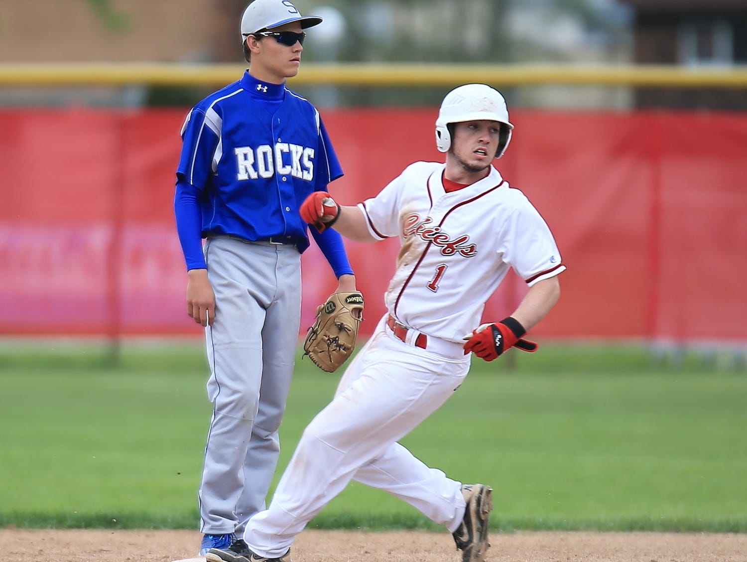 Rounding into second base for Canton during Thursday's game is senior Nick Durocher (No. 1). Also shown is Salem's Erich Payne.