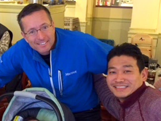 From left, Dr. Geoff Tabin and Ongyel Sherpa with Sherpa's daughter. When Sherpa was 18 years old, he was given a once-in-a-lifetime opportunity by Dr. Geoff Tabin, who met Sherpa on a trip to Nepal as part of the Himalayan Cataract Project, to come to Vermont to live with Tabin's family and babysit his young children.