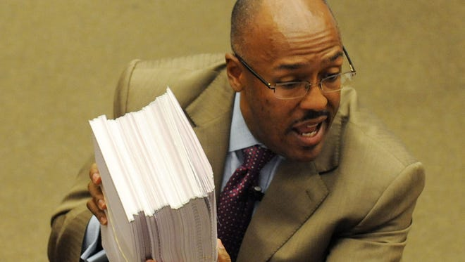 In this July 30, 2013, file photo, Precious Martin shows evidence to the jury as he makes his closing argument during the Ware v. DuPree trial in Hattiesburg. Martin died Sunday, May 11, 2014, after the ATV he was riding flipped.
