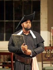 Ryan Speedo Green performs in a scene from an opera.