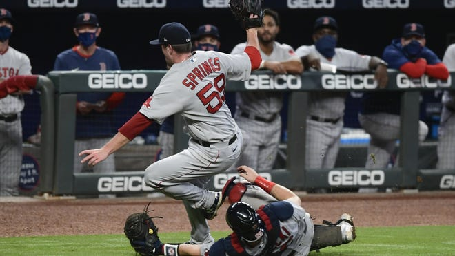 Red Sox pitcher Jeffrey Springs (front left) falls over catcher Kevin Plawecki as they go for a foul ball hit by Braves catcher Travis d'Arnaud during the ninth inning of a baseball game Friday, Sept. 25, 2020, in Atlanta.
