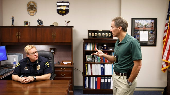 High Point Police Chief Marty Sumner, left, and Detective J.W. Thompson discuss the department's domestic violence prevention program, in High Point, N.C. As part of the program, Thompson will personally serve formal notices at the city's jail to domestic violence offenders, putting them on formal notice that they will be monitored on an ongoing basis and treated harshly for any re-offense regardless of whether their victim formally complains or not.