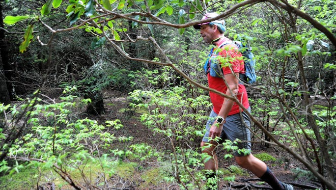 Black Mountain native Kenny Capps nears the end of his Throwing Bones for a Cure Run, the 1,175-mile traverse of the Mountains-to-Sea Trail that he began April 1.
