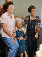 """Rosaria """"Sara"""" Martinico, center, sits with her two daughters, Josephine Strnad, left, and Betty Strnad, during Rosaria's 108th birthday at her home in Rochester Hills, Mich., Sunday, July 22, 2018."""