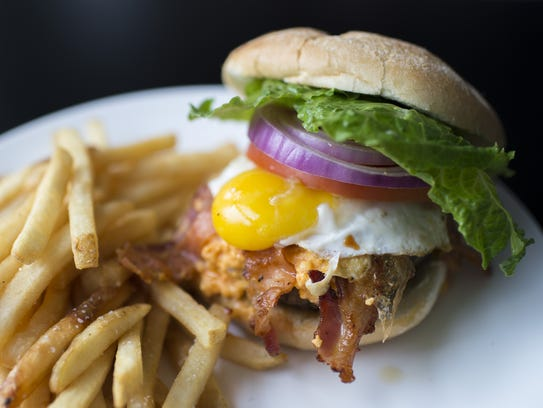 A deluxe burger topped with beer cheese, bacon and a fried egg from The Red Hen in Swedesboro