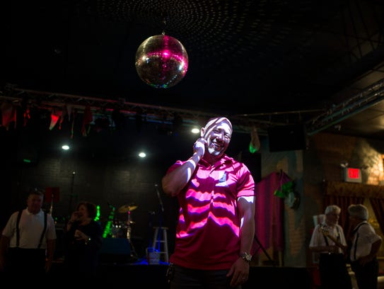 Co-owner Joe Harris poses under a disco ball Friday,