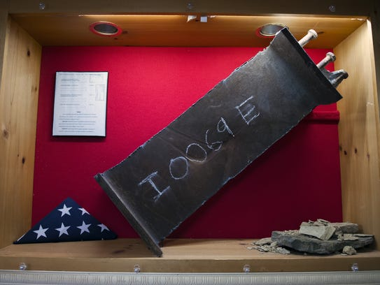 A beam from the World Trade Center on display at American