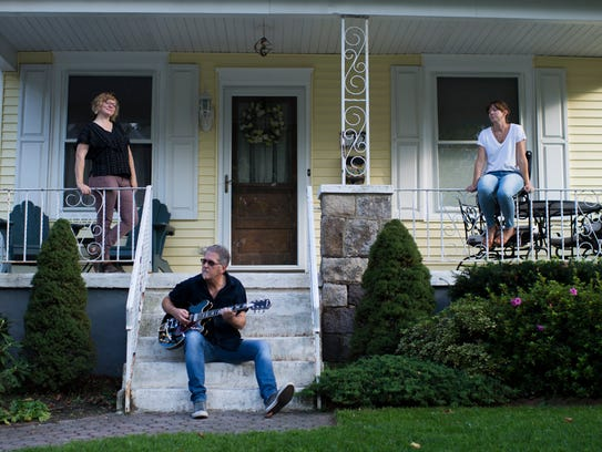 Stacey Brown Downham (from left), Kevin Monko and Sara Neal gather on a Collingswood porch to promote Collingswood's first Porchfest, which took place last fall. Brown Downham is an organizer of East of Philly, and some artists involved in that series may also show up at the next Porchfest, organizers say.