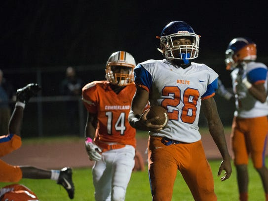 Millville's Clayton Scott (28) rushes into the end