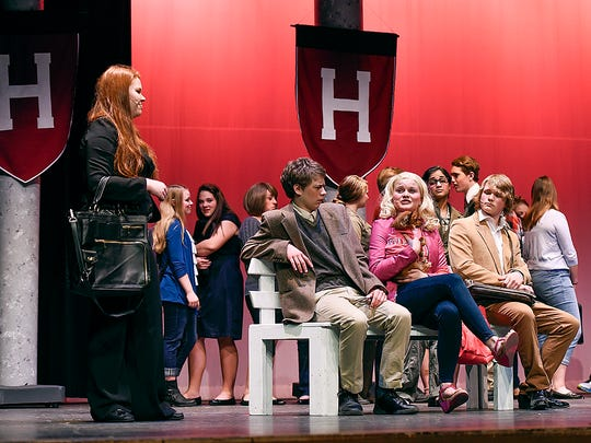 """Elle Woods, played by Lauren Davis, center, meets some of her new classmates at Harvard Law School during """"Legally Blonde"""" Thursday, May 5, at the Rocori High School in Cold Spring."""