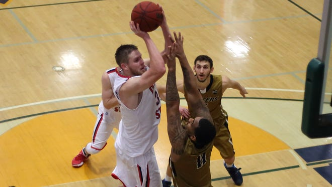 Dixie State's Zac Hunter attempts a shot during the PacWest semifinal game against California Baptist. CBU beat DSU 90-73.