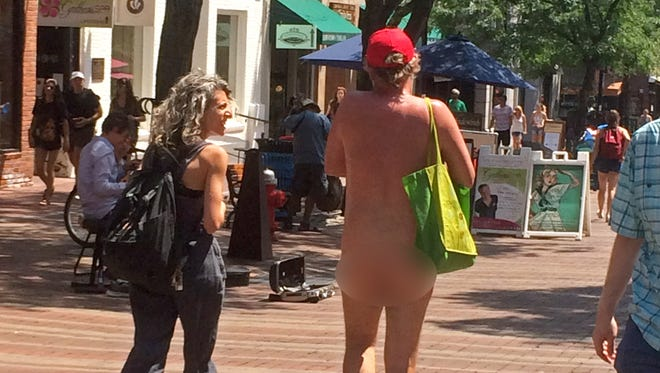 Free Press journalist Emilie Stigliani attempts to interview a naked man who was spotted making several loops around downtown Burlington on Thursday, July 5, 2018. Editor's note: The man's behind has been blurred.