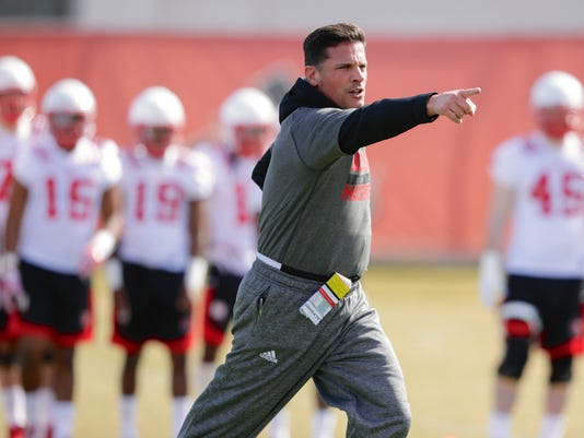 FILE - In this March 4, 2017, file photo, Nebraska defensive coordinator Bob Diaco works with players on the first day of spring NCAA college football practice in Lincoln, Neb. Diaco's three seasons as coach at Connecticut did not go well, but his resume as defensive coordinator at Notre Dame was pretty good so Mike Riley brought him in to remake the Cornhuskers' defense. (AP Photo/Nati Harnik, File)