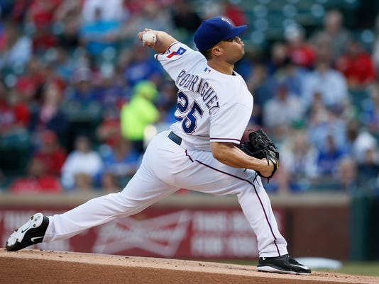 Texas Rangers' Wandy Rodriguez (25) delivers a pitch against the Seattle Mariners during the first inning of a baseball game Wednesday, April 29, 2015, in Arlington, Texas. (AP Photo/Tony Gutierrez)