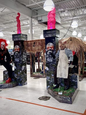 An elaborate animatronic display greets customers walking into the Swansea Spirit of Halloween store.  Herald News photo by Charles Winokoor