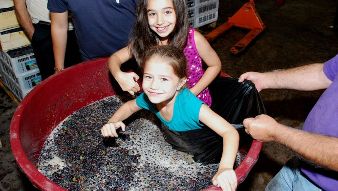 Gianna and Melaina Gargano of Hicksville, N.Y., visit Grape Expectations in Bridgewater, and join in the creation of their parents' custom-made barrel of Cabernet Sauvignon.
