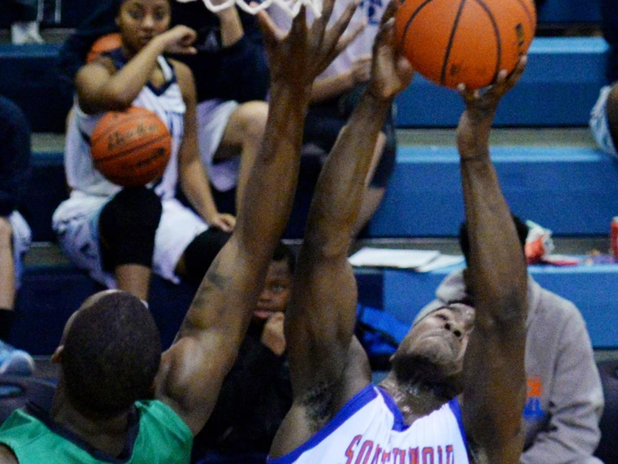 """Southwood's Shakelvin Calhoun grabs a rebound during the """"Doc'' Edwards Invitational last month."""